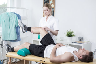 therapist assisting a patient